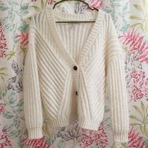 Thick knitted white cardigan
